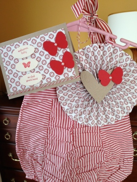 Present for a baby girl. I didn't find any bags I liked so I just put it on a hanger and made the rossette and card.