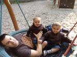 Three boys on a swing