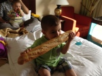 Evan discovering the delightful flavor of a fresh baguette