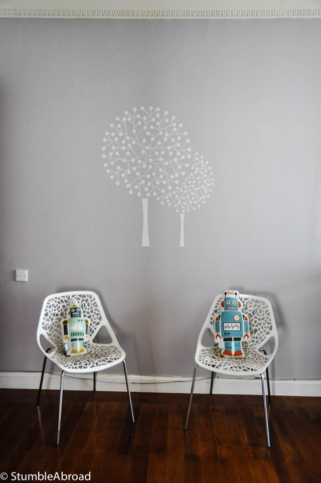 "We decided to have a ""floating"" tree because we usually Joshua's crib there. In preparation for Dany's visit we have a couple of chairs."