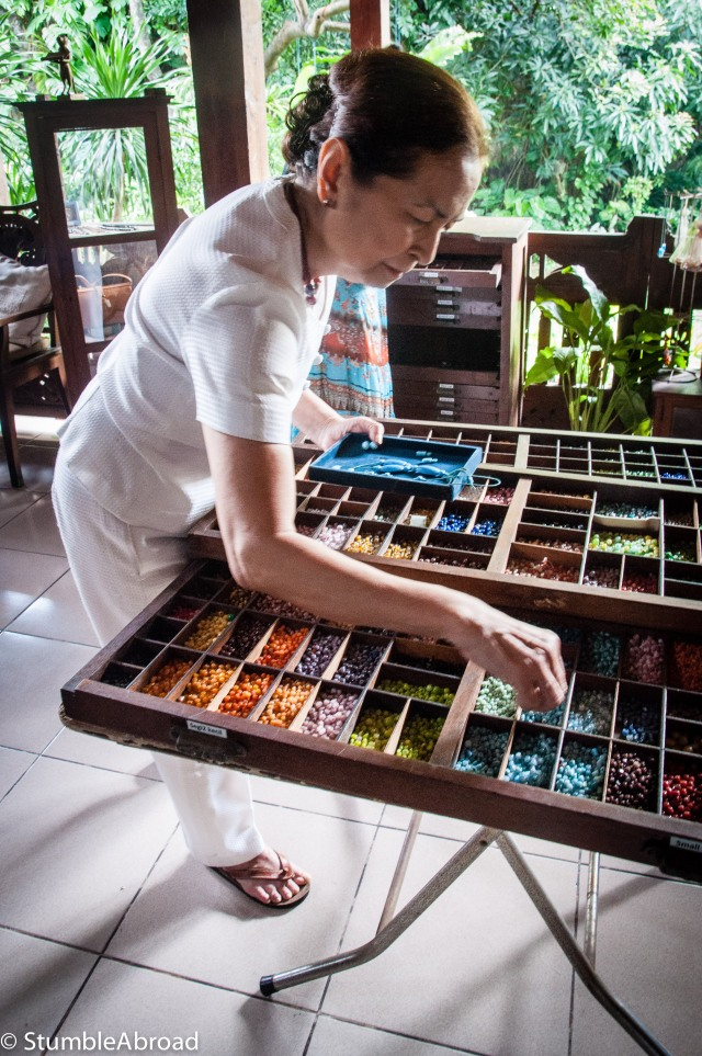 Ibu Yekti finding the perfect bead