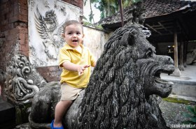 Josh riding on the guard lion