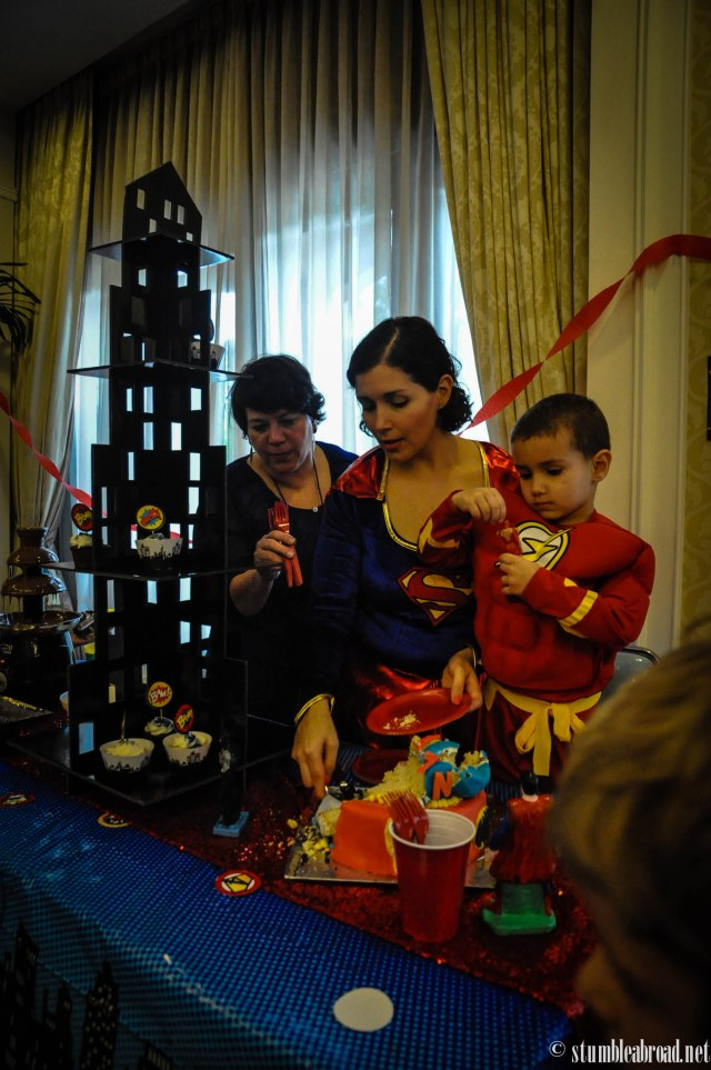 Three generation concentrating on cutting the cake